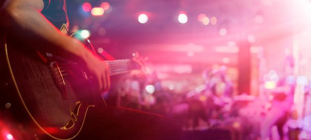 guitarist-stage-background-soft-blur-concept_34200-251
