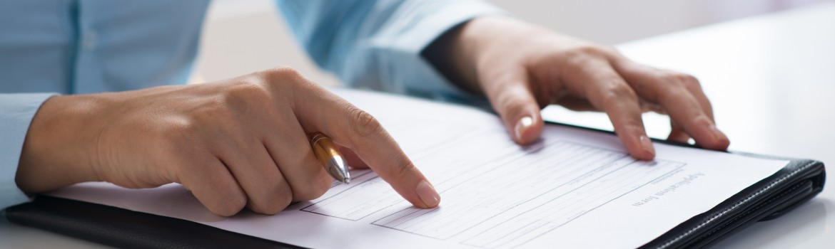 Closeup of person reading and studying document